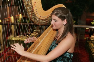 Sarah playing the harp